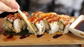 Uramaki of shrimp tempura stock footage