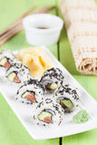 Uramaki sushi with avocado, raw salmon and black sesame Stock Photo