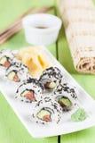 Uramaki sushi with avocado, raw salmon and black sesame. Shallow dof stock photo