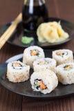 Uramaki sushi with carrot, cucumber, surimi and roasted white se. Same. Shallow dof stock photography