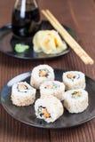Uramaki sushi with carrot, cucumber, surimi and roasted white se. Same. Shallow dof royalty free stock image