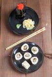 Uramaki sushi with carrot, cucumber, surimi and roasted white se. Same. Shallow dof stock photo