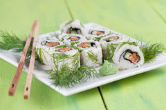 Uramaki sushi with cucumber, raw salmon and dill. Shallow dof stock photography
