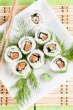 Uramaki sushi with cucumber, raw salmon and dill. Shallow dof stock photos