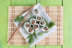 Uramaki sushi with cucumber, raw salmon and dill. Shallow dof Royalty Free Stock Images