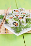 Uramaki sushi with cucumber, raw salmon and dill. Shallow dof Stock Photo