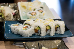 Uramaki sushi rolls with fresh salmon, avocado and philadelphia cheese Royalty Free Stock Photos