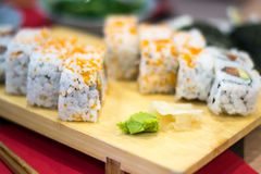 Uramaki sushi rolls with fresh salmon, avocado and philadelphia cheese Royalty Free Stock Photography