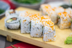 Uramaki sushi rolls with fresh salmon, avocado and philadelphia cheese Stock Photos