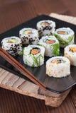 Uramaki sushi set. On a plate. Shallow dof royalty free stock images