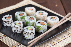 Uramaki sushi set. On a plate. Shallow dof stock photos