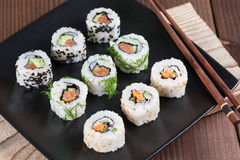 Uramaki sushi set. On a plate. Shallow dof stock images