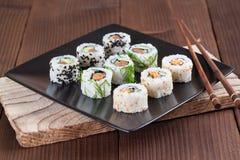 Uramaki sushi set. On a plate. Shallow dof stock photography