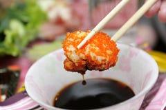 Uramaki sushi in soy sauce Royalty Free Stock Image