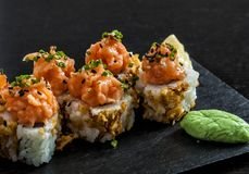 Uramaki topped with salmon and wasabi stock image