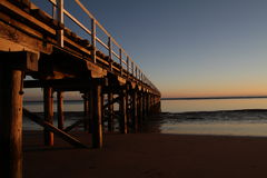 Urangan Pier Sunrise. Urangan Pier at sunrise, near Hervey Bay, Queensland Stock Photo