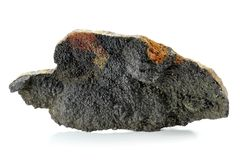 Uraninite. Found in Oberschlema (Ore Mountains/ Germany) isolated on white background Stock Photo