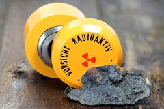 Uraninite. With storage container for radioactive materials Royalty Free Stock Photos