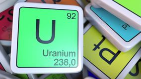 Uranium U block on the pile of periodic table of the chemical elements blocks. 3D rendering Stock Photography