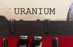 Uranium typed in a vintage paper. Close up shot using a vintage typewriter Royalty Free Stock Photos