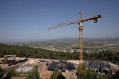 Żurawie ładują przewożenie budynku budowę Fotografia Stock