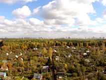 Urban. A village on the front, a city on the horizon and a forest between Royalty Free Stock Photo