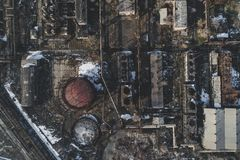 Urban abandoned factory. Urban abandoned old factory shot with a drone. Bird`s view - Global Warming stock photography