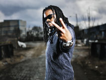 Urban african man showing peace sign. Royalty Free Stock Photography