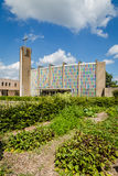 Urban agriculture: a vegetable garden beside a church building i Royalty Free Stock Image