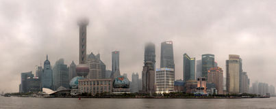 Urban Air Pollution in Chinese Cities, Smog over Shanghai, Lujiazui. Shanghai, China - April 20, 2010: Air Pollution in City, Buildings are shrouded in smog stock photography