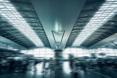 Urban airport terminal with rushing passengers Royalty Free Stock Image