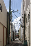 Urban Alley. A narrow urban alley in a southern US city Royalty Free Stock Image