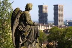 Glasgow Necropolis Graveyard. Glasgow Necropolis burial ground statue of Victorian angel contemplating two modern high rise tower blocks against the skyline Stock Images