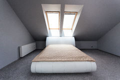Urban apartment - attic bedroom Royalty Free Stock Image