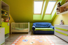 Urban apartment - cute room. Urban apartment - sweet colorful room on the attic stock photo