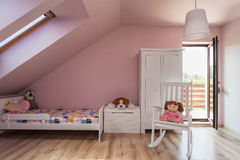 Urban apartment - girl's room. Urban apartment - pink girl's room on the attic Stock Images