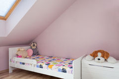 Urban apartment - girls furniture. Urban apartment - wooden bed in child's room Royalty Free Stock Photography