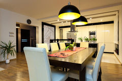 Urban apartment - Wooden table in dining room. Urban apartment - Wooden table in modern dining room Stock Photography
