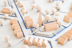 Urban Architectural Model of small Village with church,. Architecture in shape of a model out of wood and paper showing small row houses and a church with some Royalty Free Stock Images