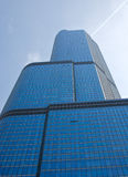 Urban Architecture. A skyscraper in Chicago, Illinois, with reflective windows and an airplane's contrail in the sky Stock Photography