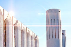 Urban architecture view of concrete walls and columns built in futuristic urban style. Royalty Free Stock Photography