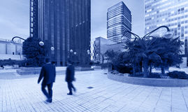 Urban area with people in movement. Blue tone Stock Photo