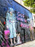 HRH Queen Elizabeth and Corgi `God save the Queen` graffiti. Urban art on a boarded up building in London by Mr Brainwash, real name Thierry Guetta Royalty Free Stock Photo