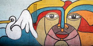 Urban Art . face and pelican. Photo of a mural painted on a wall . Cumana , Venezuela , South America. Shows an abstract multicolors face with a pelican Royalty Free Stock Photography
