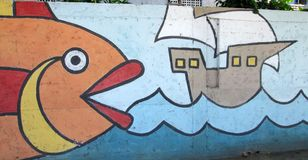 Urban art. Huge fish stock photos
