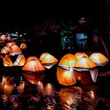 Urban Art Installation - Camping Tents Over Creek royalty free stock images