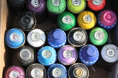 Urban Art - Spray Paint. Close up of bright colored spray paint cans used for graffiti art Stock Images
