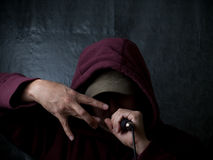 Urban artist - rapper. Rapper - hip hop artist wearing hood and singing to a microphone Stock Photography