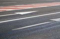 Urban asphalt road with arrows and marks on it stock image