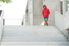Urban athlete running upstairs. Sporty man working out outside a. Nd climbing stairs Royalty Free Stock Photo